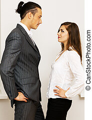 Young businessman and woman having an argument