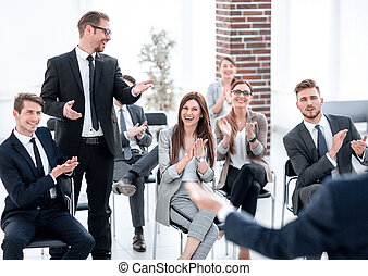 young businessman asks the speaker at a business...