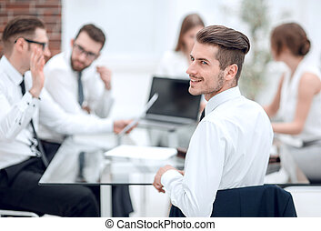 young businessman at a working meeting with the business team.