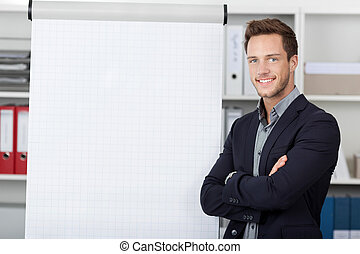 Young Businessman At Flipchart