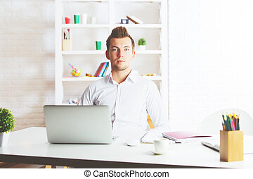 Young businessman at workplace