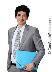 Young businessman blue folder
