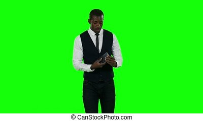 Young businessman cell phone. Green screen