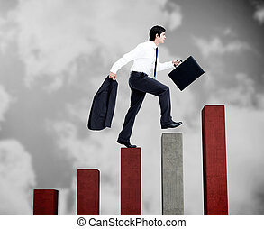 Young businessman climbing grey and red steps on black white...