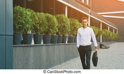 Young businessman dressed in business clothes goes to work.