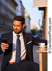 Young businessman drinking coffee