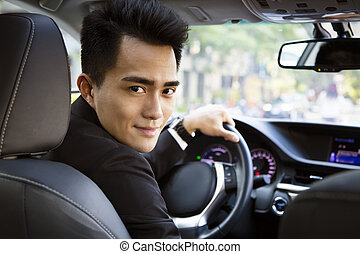 young businessman driving in the car
