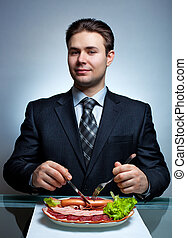 Young businessman eating