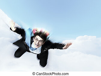 Young businessman flying with parachute on back - Conceptual...