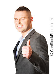 Young businessman gesturing ok sign