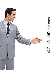 Young businessman giving his hand