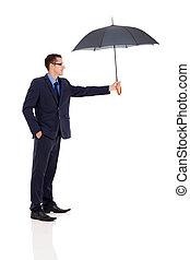 young businessman giving umbrella