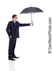 young businessman giving umbrella