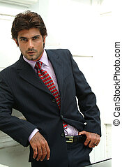 Handsome young businessman looking