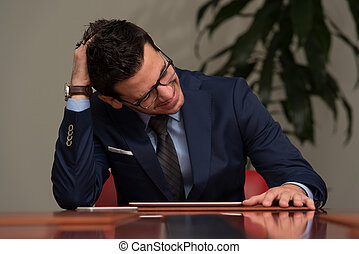 Young Businessman Having Stress In The Office