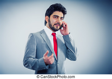 young businessman holding a cell phone copyspace