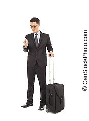 Young businessman holding a cell phone  with briefcase