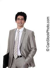 young businessman holding a laptop