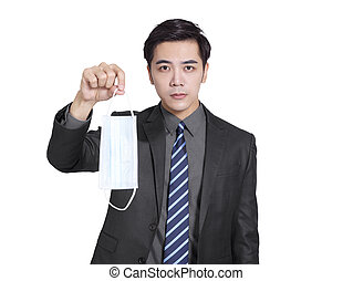 young  businessman holding a medical mask. During the covid-19 epidemic, he should always wear the mask by his side