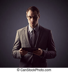 Young businessman holding a tablet