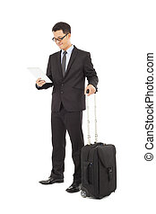 Young businessman holding a tablet with briefcase