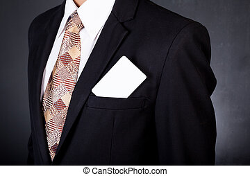 young businessman holding card in hand