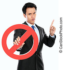 Young businessman holding prohibited sign