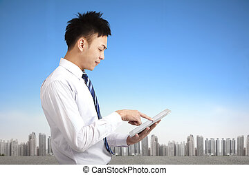 young businessman holding touch pad tablet pc