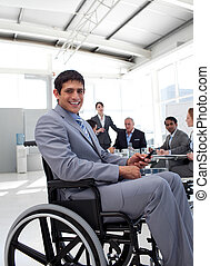 Young businessman in a wheelchair at a meeting