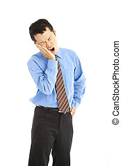 young businessman in agony with a toothache over white...