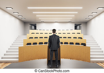 Young businessman in auditorium