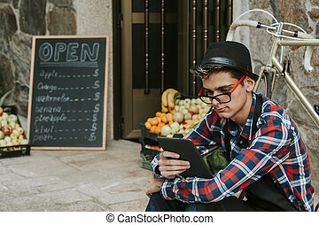 young businessman in business with tablet