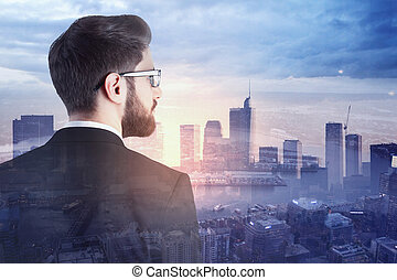 Young businessman in city