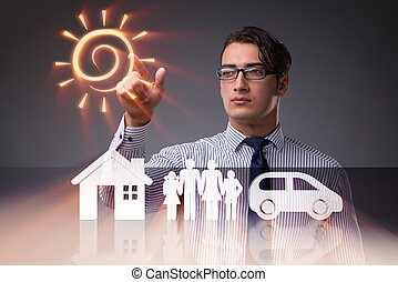 Young businessman in insurance concept