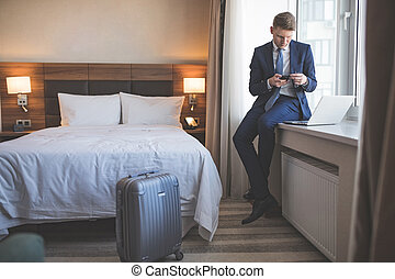 Young businessman in room