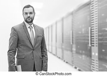 Young businessman in server room