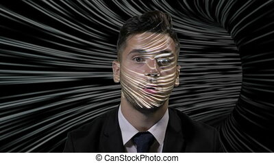 Young businessman in suit playing a game in which he travels through a maze using augmented virtual reality
