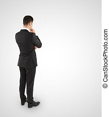 young businessman in suit thinking on a white background