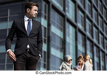 Young businessman in the city