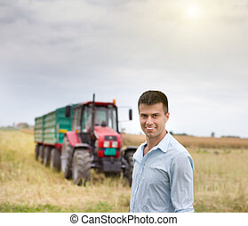 Young businessman in the field