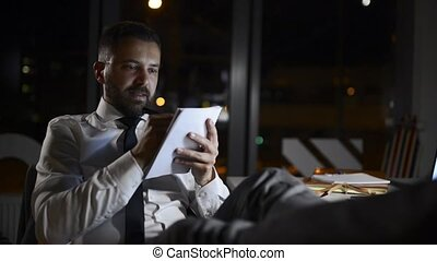Young businessman in the office working at night.