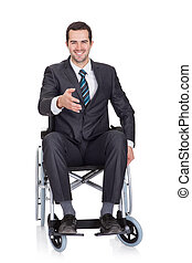 Young businessman in wheelchair. Isolated on white