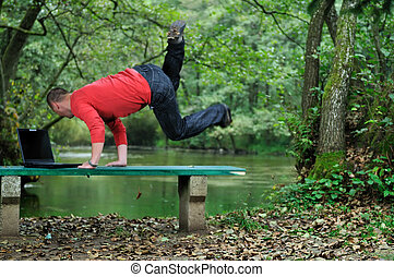 young businessman jump outdoor - young businessman jump over...