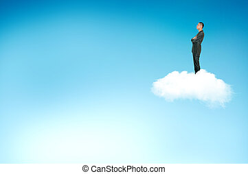 Young businessman look at the sky on the cloud