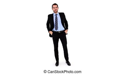 Young businessman looking at camera on white background