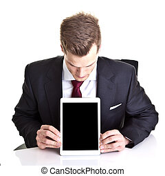 Young businessman looking at empty space on his modern tablet co