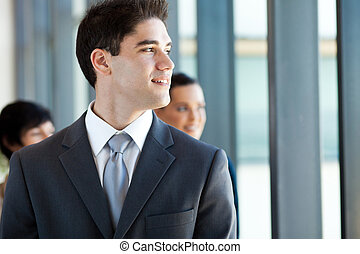 businessman looking outside office