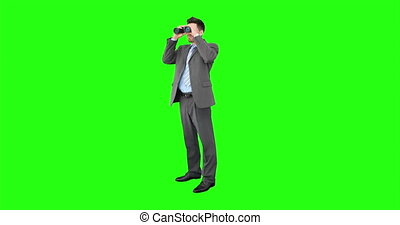 Young businessman looking through