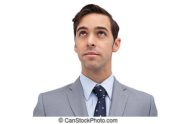 Young businessman looking up