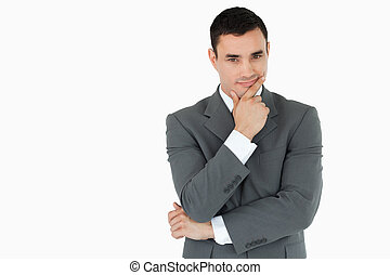 Young businessman lost in thoughts